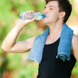 Man drinking water after fitness — Stock Photo #19954225
