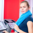 Young woman at the gym run on on a machine — Stock Photo #19954861