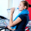 Woman at the gym drinking water — Stock Photo #19954865