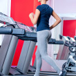 Young woman at the gym run on on a machine — Lizenzfreies Foto