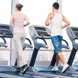 Woman and man at the gym exercising. — Foto Stock