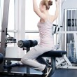 Woman doing stretching exercise at the gym — ストック写真