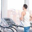 Man at the gym exercising. Run. — Stock Photo #19955673