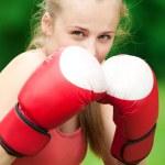 Young boxer woman at green park — Stock Photo