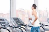 Man at the gym exercising. Run. — Stock Photo