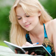 Beautiful young woman read book - Stock fotografie