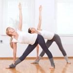 Women doing yoga exercise at gym — Stock Photo