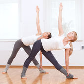 Women doing yoga exercise at gym — Stock Photo