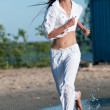 Sporty woman running on water — Stock Photo #19975201