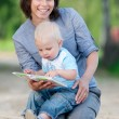 Mother with son reading a book - Stock fotografie