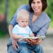 Royalty-Free Stock Photo: Mother with son reading a book