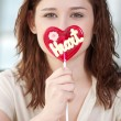 Pretty woman with candy heart — Stock Photo #19973925