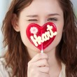 Pretty woman with candy heart — Stock Photo