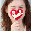 Stock Photo: Pretty womwith candy heart