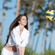 Woman playing volleyball on beach — Stock Photo