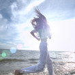 Sporty woman running in sea coast — Stock Photo