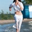 Sporty woman running on water — Stock Photo #19976171