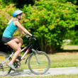 Young smiling woman on bike — Stockfoto