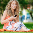 Woman texting on mobile phone — Stock Photo