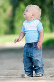 Happy little boy in the green park — Stock Photo