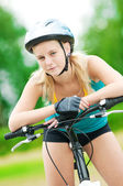 Young smiling woman on bike — Stock Photo