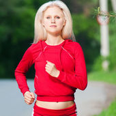 Beautiful woman running in park — Stock Photo