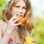 Smiling woman drinking orange juice — Stock Photo #19980023