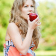 Beautiful woman with red apple — Stock Photo #19980113