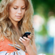 Woman texting on mobile phone — Stock Photo #19980193
