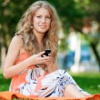 Woman texting on mobile phone — Stock Photo #19980197
