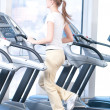 Stock Photo: Young womat gym exercising. Running