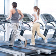 Young woman and man at the gym exercising. Running — Stock Photo