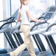 Young woman at the gym exercising. Running — Zdjęcie stockowe