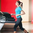 Gym exercising. Run on on a machine — Stock Photo