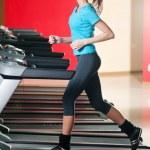 Gym exercising. Run on on a machine — Stock Photo