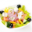 Greek salad on the white background  — Stockfoto