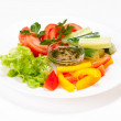 Fresh summer salad on white plate — Stock Photo