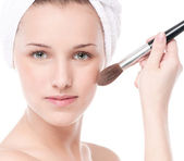 Beautiful woman with make up brush — Stock Photo