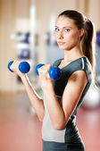 Beautiful sport woman doing exercise with dumbbell — ストック写真