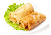 Rolled pancakes - russian blini — Stock Photo