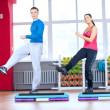 Man and woman at the gym doing stretching - Stockfoto