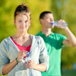 Man and woman drinking from bottle — Stock Photo #23757799
