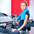 Young woman at the gym run on on a machine — Zdjęcie stockowe
