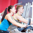 Stock Photo: In the gym doing cardio cycling training