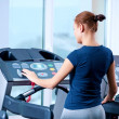 Royalty-Free Stock Photo: Young woman at the gym run on on a machine