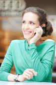 Beautiful business woman talking on cell phone — Stock Photo