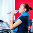 Royalty-Free Stock Photo: Woman at the gym drinking water