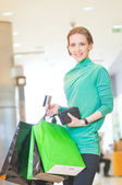 Shopping woman with color bags — Стоковое фото