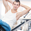 Young man doing exercises at gym — Stock Photo