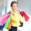 Shopping woman with color bags — Stock Photo #32885909